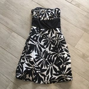 Black and white patterned strapless dress.